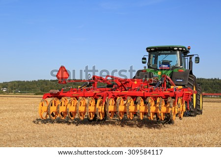 SALO, FINLAND - AUGUST 21, 2015: New Vaderstad Opus 400 cultivator and John Deere tractor on field at the set up of Puontin Peltopaivat Agricultural Harvesting and Cultivating Show. - stock photo
