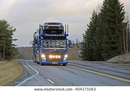 SALO, FINLAND - DECEMBER 11, 2015: Volvo FM car carrier of Kurbads hauls new cars. The Finnish automotive industry estimates that a total of 109,000 new passenger cars will be sold in Finland in 2015. - stock photo