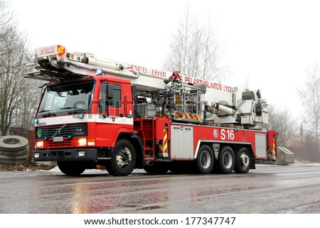 SALO, FINLAND - FEBRUARY 16, 2014: Volvo FL12 Intercooler fire engine arrives at the Cement Factory fire scene in Salo, Finland. - stock photo