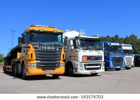 SALO, FINLAND - JUNE 21: Row of trucks on a parking lot in Salo, Finland on June 21, 2013. The Finnish government allows heavy goods vehicles of up to 76 tonnes on  roads from August 1, 2013. - stock photo