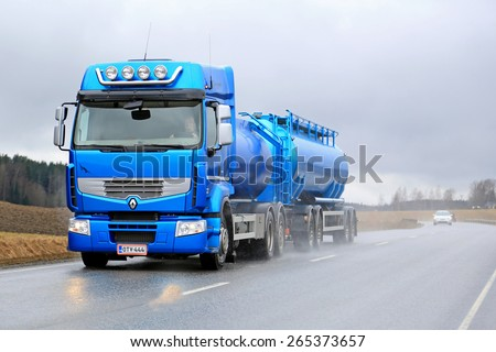 SALO, FINLAND - MARCH 28, 2015: Blue Renault Premium 460 tank truck on the road. Renault Trucks announces laboratory vehicle's fuel consumption lowered by 22 % after intense testing. - stock photo