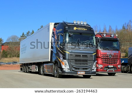 SALO, FINLAND - MARCH 14, 2015: New Volvo FH and Mercedes-Benz Arocs trucks parked. Volvo and Mercedes-Benz are among top three in the Finnish first time registrations of heavy trucks in 2014.  - stock photo