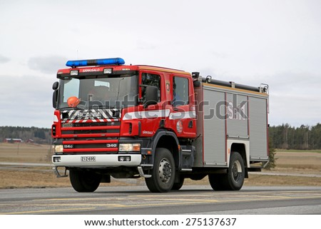 SALO, FINLAND - MARCH 22, 2015: Scania 114C 340 Fire truck moves along highway 52. Scania fire trucks have been used by Finnish fire departments for over 100 years. - stock photo
