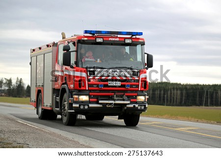 SALO, FINLAND - MARCH 22, 2015: Scania Fire truck on highway 52. A traditional Scania water-rescue tender is typically built in a 4x2 or 4x4 configuration, with a 6 to 8 person CrewCab.