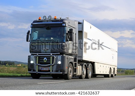 SALO, FINLAND - MAY 13, 2016: Grey Renault Magnum semi truck transports mobile MRI unit in South of Finland on a blue spring evening.  - stock photo