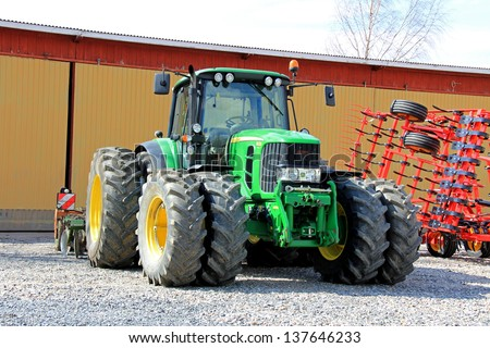 SALO, FINLAND - MAY 4: John Deere 6630 Tractor in Salo, Finland on May 4, 2013. For 7th straight year, Deere & Company earns position on Ethisphere Institute's World's Most Ethical Companies list. - stock photo