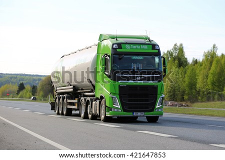 SALO, FINLAND - MAY 13, 2016: Lime green Volvo FH 500 semi tank truck drives along motorway in South of Finland on a spring evening.  - stock photo