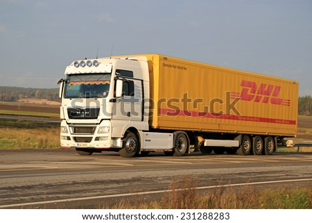 SALO, FINLAND - NOVEMBER 16, 2014: MAN TGX 18.480 Truck hauls DHL trailer. DHL launches freight capacity management program due to rapidly increasing trade volumes. - stock photo