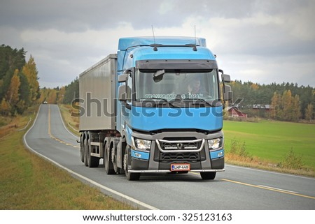 SALO, FINLAND - OCTOBER 4, 2015: Blue Renault Trucks T Semi moves along road in Salo. Renault Trucks T is the International Truck of the Year 2015. - stock photo