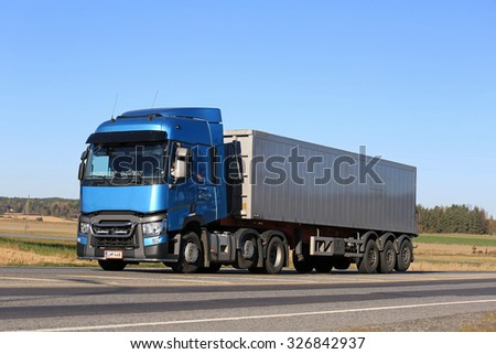 SALO, FINLAND - OCTOBER 11, 2015: Blue Renault Trucks T Semi moves along road in Salo. Renault Trucks T is the International Truck of the Year 2015. - stock photo