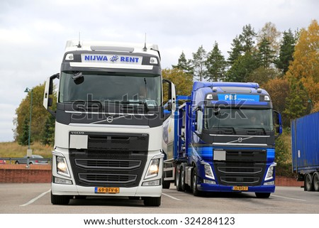SALO, FINLAND - OCTOBER 4, 2015: Two Volvo FH tank trucks leave Salo. Volvo Trucks launches positioning service for time-critical transports. - stock photo