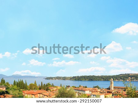 Salo village and garda lake, blue sky background with clouds and copy space - stock photo
