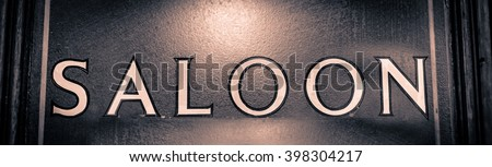 Saloon sign on the door to the English pub in London - stock photo