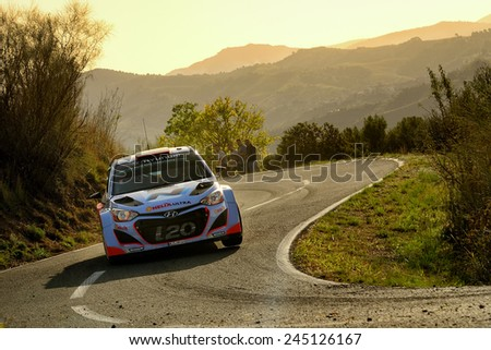 SALOU, SAPIN - OCT 25: Spanish driver Dani Sordo and his codriver Marc Marti in a Hyundai i20 WRC race in the 50th Rally RACC Rally of Spain, on Oct 25, 2014 in Salou, Spain. - stock photo