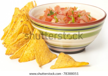 Salsa dip with tortilla chips. Coarsely chopped dip in a bowl surrounded by tortillas isolated on white. - stock photo