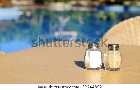 Salt and pepper on a table - stock photo