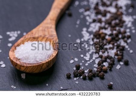 Salt and Pepper on dark background - stock photo