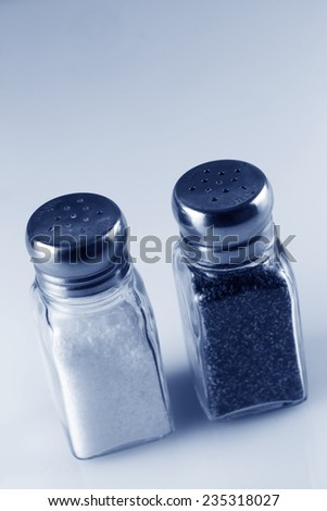 Salt and Pepper Shakers in Blue Tint - stock photo