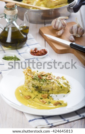 Salt cod in a pilpil sauce a typical Spanish recipe - stock photo