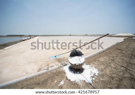 Salt fields - sea salt in Thailand  - stock photo