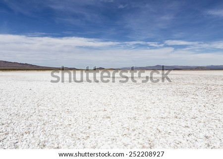 Salt flat dry lake near Zzyzx in California's vast Mojave desert. - stock photo