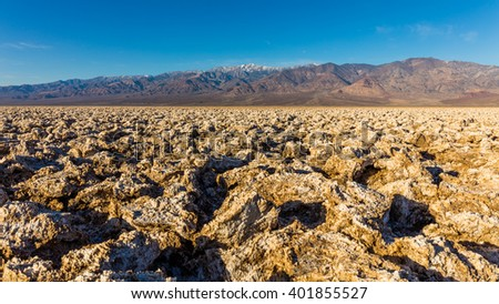 Salt has created complex structures. A large salt pan on the floor of Death Valley. Devil's Golf Course, Death Valley National Park - stock photo