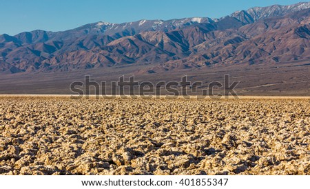 Salt has created complex structures. A rough texture from the large salt crystal formations.The floor of Death Valley is covered by a huge salt pan. Devil's Golf Course, Death Valley National Park - stock photo
