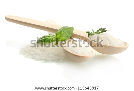 salt in spoons with fresh basil and thyme isolated on white - stock photo