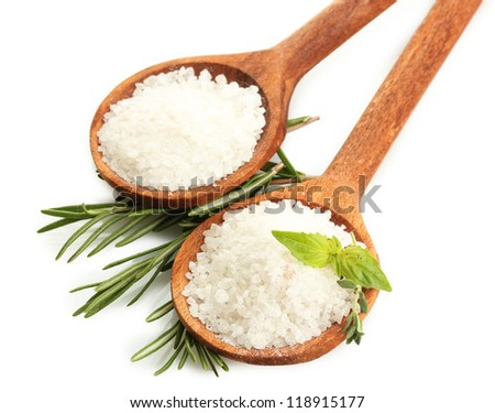 salt in spoons with fresh basil, thyme and rosemary isolated on white - stock photo