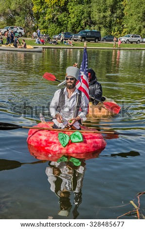 SALT LAKE CITY, UT - OCTOBER 17, 2015: People dressed up to participate in the 5th Annual Ginormous Pumpkin Regatta 2015 at Sugarhouse Park - stock photo