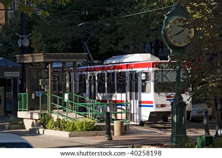 Salt Lake City, Utah, a view of the trolley station and a town clock - stock photo