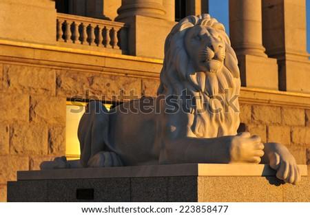 SALT LAKE CITY, UTAH - DECEMBER 25, 2011: Lion of the State Capitol Building in Salt Lake City, Utah at sunset.  - stock photo