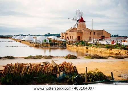 Salt mills are seen in suburbs of Marsala, Sicily, Italy. - stock photo