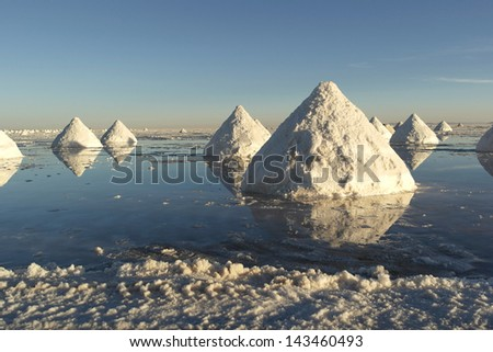 Salt mining piles on the Salar de Uyuni in Bolivia - stock photo