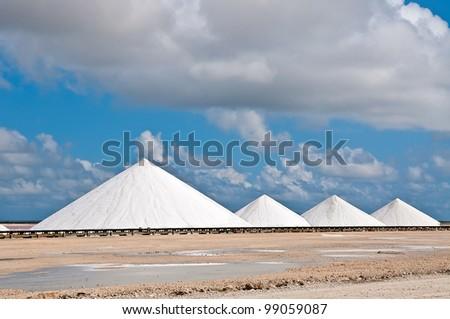 Salt mountains. Extraction of salt on the island of Bonaire, Dutch Antilles, Caribbean. - stock photo