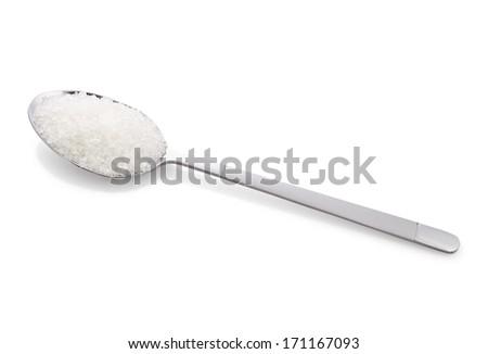 Salt or sugar on a teaspoon on white background, isolated - stock photo
