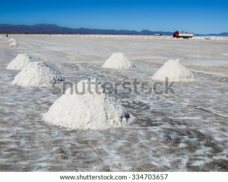 Salt piles on Salar de Uyuni where salt is produced, Bolivia - stock photo