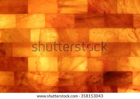 Salt stone wall in a Salt Cave Salarium  - stock photo