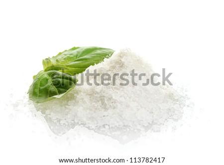 salt with fresh basil isolated on white - stock photo