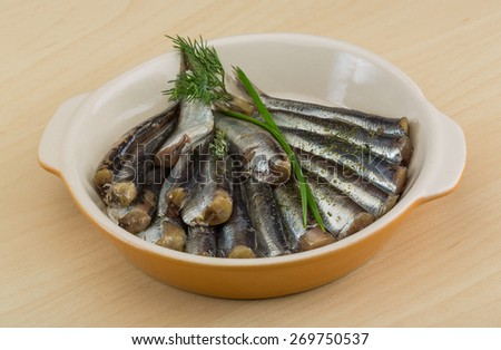 Salted anchovy with spices and herbs - ready for eat - stock photo