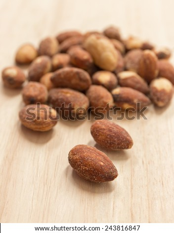 Salted and roasted Almonds . - stock photo