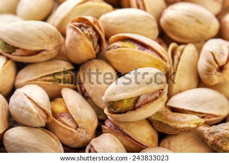 Salted and roasted pistachio nuts closeup for backgrounds - stock photo