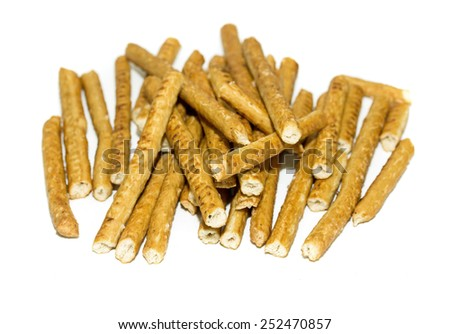 salted bread sticks on white background - stock photo