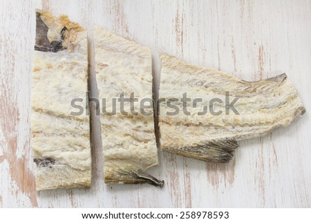 salted cod fish on white background - stock photo