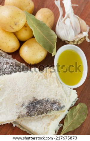 salted codfish with potato, oil and garlic - stock photo