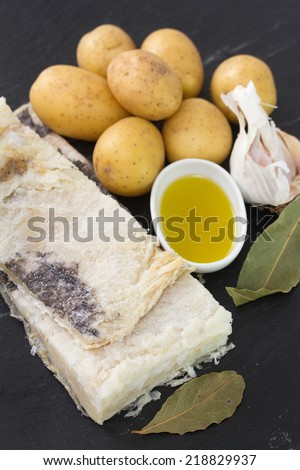 salted codfish with potato, olive oil and garlic - stock photo
