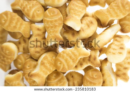 salted cookies stack on white background. - stock photo