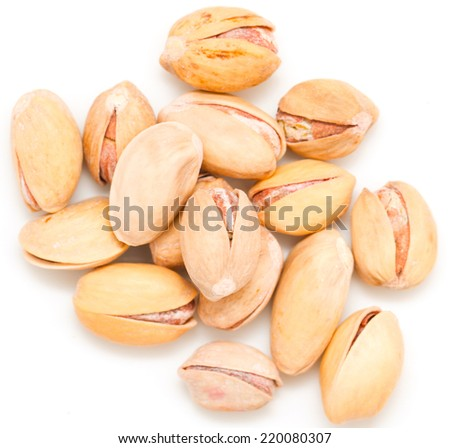 Salted pistachios on white background - stock photo