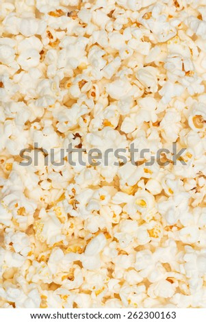 Salted popcorn grains on background - stock photo