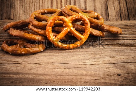 Salted pretzel snacks on the old wooden background - stock photo